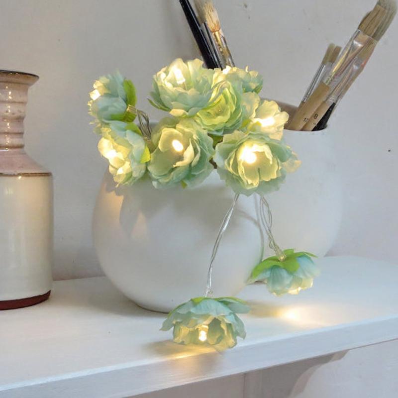 Siniste lilledega tulukesed