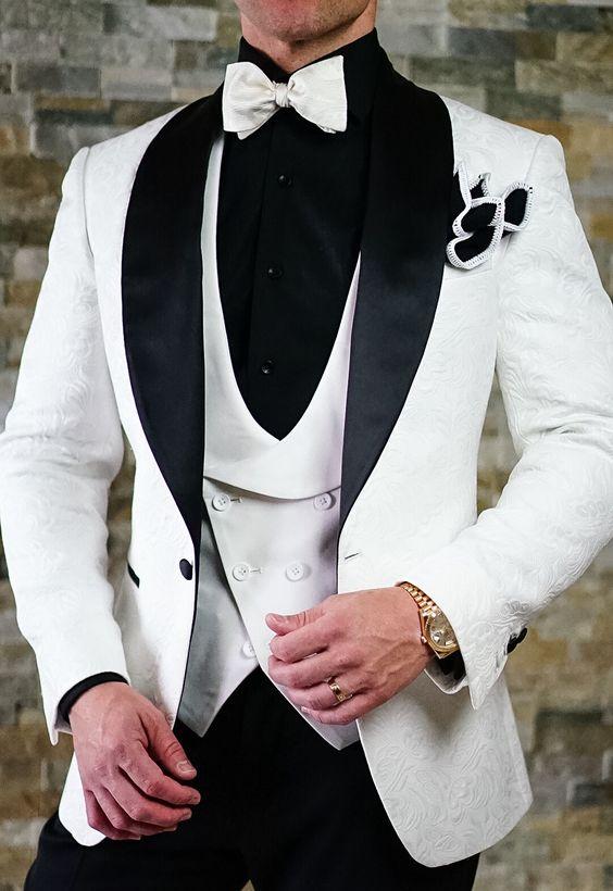 8c47d5815db Must-valge ülikond meestele