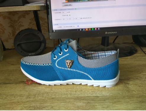 Sportlikud meeste kingad leopardi peaga